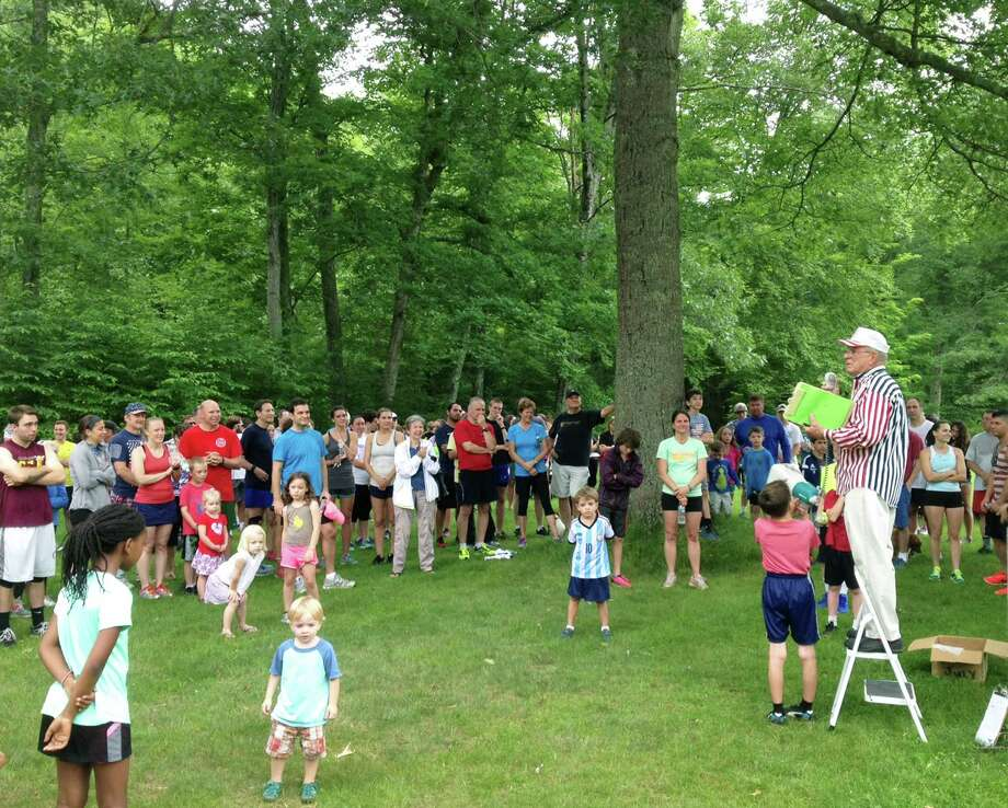 Just past the 10th anniversary of Major Stephen Reich's death in Afghanistan, his father, Ray Reich, oversees the awards ceremony for the annual Stephen Reich Freedom Run 5K road race/walk at Steep Rock in Washington. July 4, 2015 Photo: Norm Cummings / Norm Cummings / The News-Times