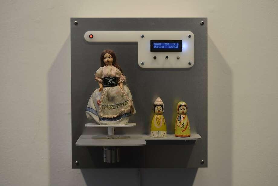 Artist Fernando Orellana displays his work at the Incline Gallery in San Francisco. Photo: Brandon Chew, The Chronicle
