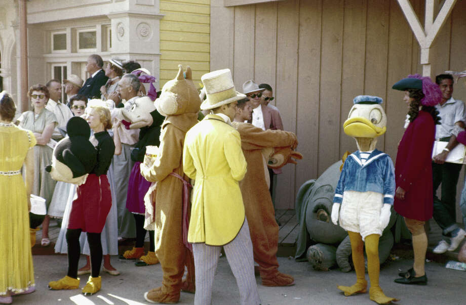 Parade participants ready themselves and their costumes for the televised grand opening of Disneyland on July 17, 1955. Minnie and Mickey (the latter with mask off) and Donald Duck are among those visible. Keep in mind it was over 100 degrees that day. Photo: Allan Grant, The LIFE Picture Collection/Gett / Time & Life Pictures