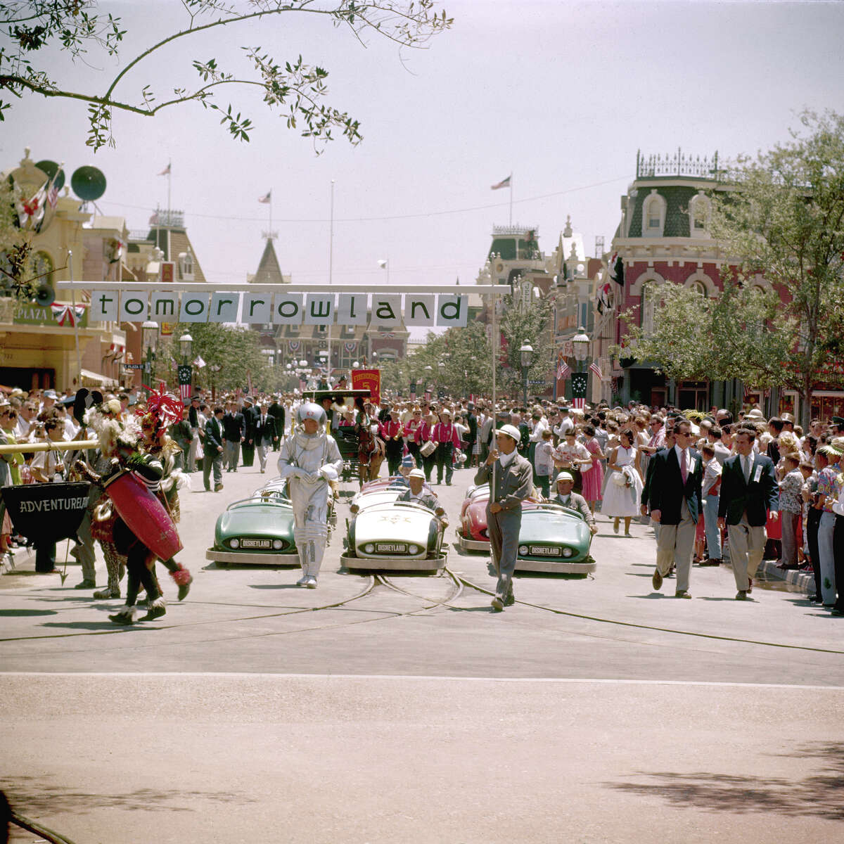 Crowds of people watch the 'Tomorrowland' portion of a parade in celebration of the opening of Disneyland Park on July 17, 1955.