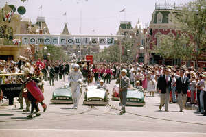 Crowds of people watch the 'Tomorrowland' portion of a parade in celebration of the opening of the Disneyland amusement park, Anaheim, California, July 17, 1955.