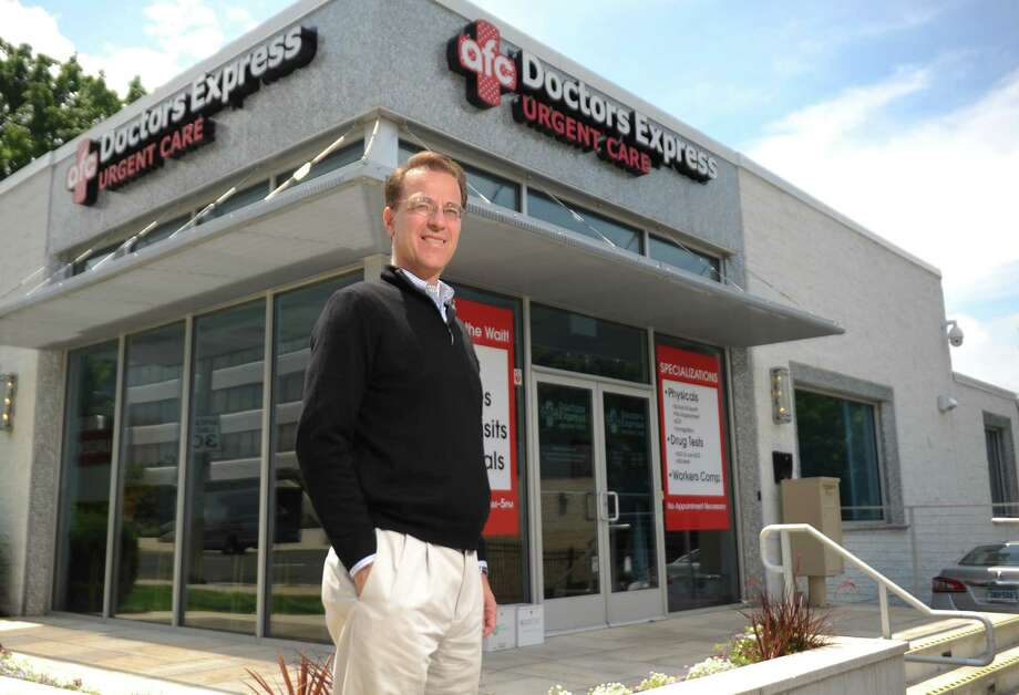 Business owner Brad Radulovacki poses outside the Doctors Express Urgent Care on Summer Street in Stamford, Conn. Wednesday, July 8, 2015.  The franchise is rapidly expanding and ownership largely comes from businessmen like Radulovacki as opposed to doctors. Photo: Tyler Sizemore / Hearst Connecticut Media / Greenwich Time