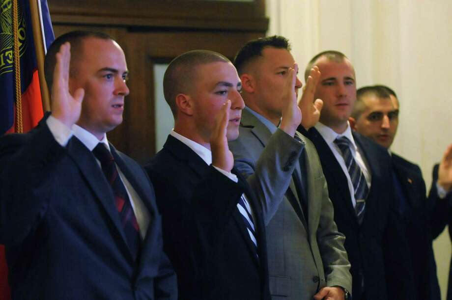 New police recruits are sworn in by Mayor Gary R. McCarthy during the swearing-in ceremony at the rotunda inside city hall on Monday, July 13, 2015, in Schenectady, N.Y. (Olivia Nadel/ Special to the Times Union) Photo: ON / 00032570A