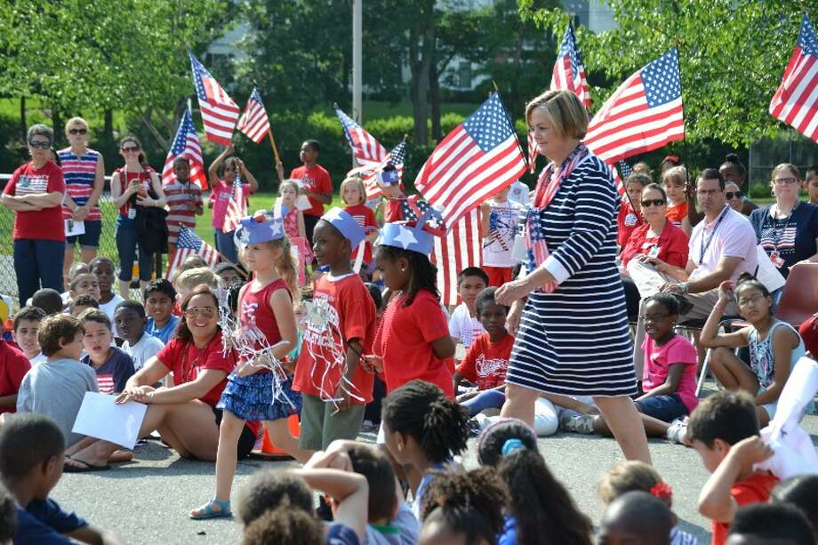 Kindergarten students lead Westover Elementary School Principal Kathleen Wunder to the podium during the school's Flag Day / 35th anniversary celebration in June. Photo: Contributed Photo / Stamford Advocate Contributed