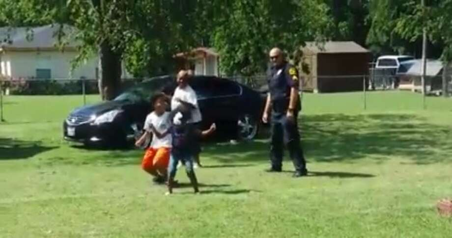 """Fireworks were not the only things popping this past Fourth of July – so were an Ennis police officer's moves when he decided to humor a few kids by dancing the """"Nae Nae"""" with them."""