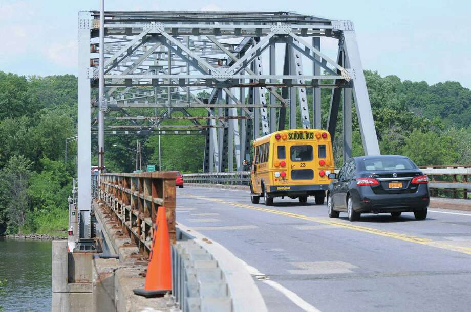 Vehicles travel on the Rexford Bridge Monday, July 13, 2015, in Rexford, N.Y. The bridge that connects Clifton Park to Niskayuna over the Mohawk River will be replaced by the state next spring. (Olivia Nadel/Special to the Times Union) Photo: ON / 00032585A