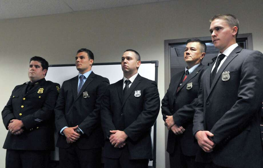 New Sergeant, Daniel Magnetto, right, stands with newly appointed officers during the Troy Police Department Promotions & Appointments Ceremony Monday, July 13, 2015, at Troy City Hall in Troy, N.Y. (Phoebe Sheehan/Special to The Times Union) Photo: PS / 00032577A