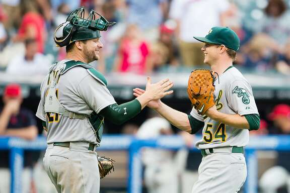 CLEVELAND, OH -  JULY 12: Catcher Stephen Vogt #21 celebrates with starting pitcher Sonny Gray #54 of the Oakland Athletics after a win over the Cleveland Indians at Progressive Field on July 12, 2015 in Cleveland, Ohio. The Athletics defeated the Indians 2-0. (Photo by Jason Miller/Getty Images)