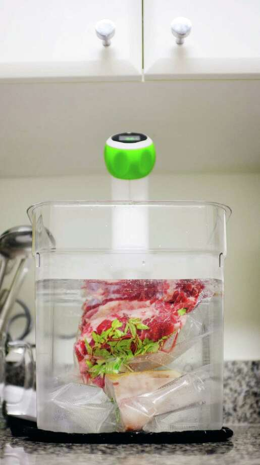 The Nomiku is one of the immersion circulators that brings sous vide - slow cooking at precise temperatures - home. Photo: Monica Lo / ONLINE_YES