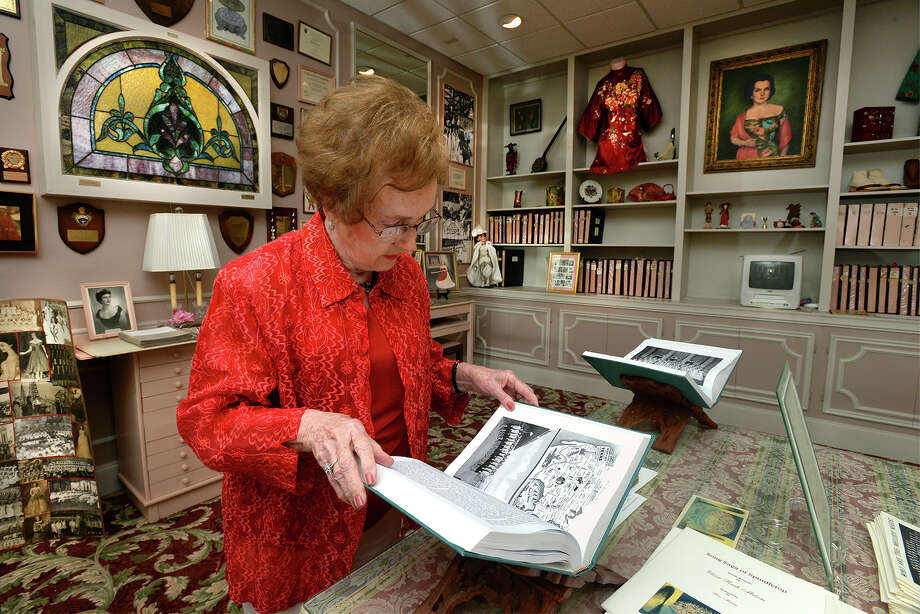 Charlene Leonard sifts through a book of Melody Maid history at the Eloise Milam Melody Maid Rose Room at the Julie Roger's Theatre on Friday. The Melody Maid group sang for service men during several American conflicts.   Photo taken Friday, July 10, 2015  Guiseppe Barranco/The Enterprise Photo: Guiseppe Barranco, Photo Editor
