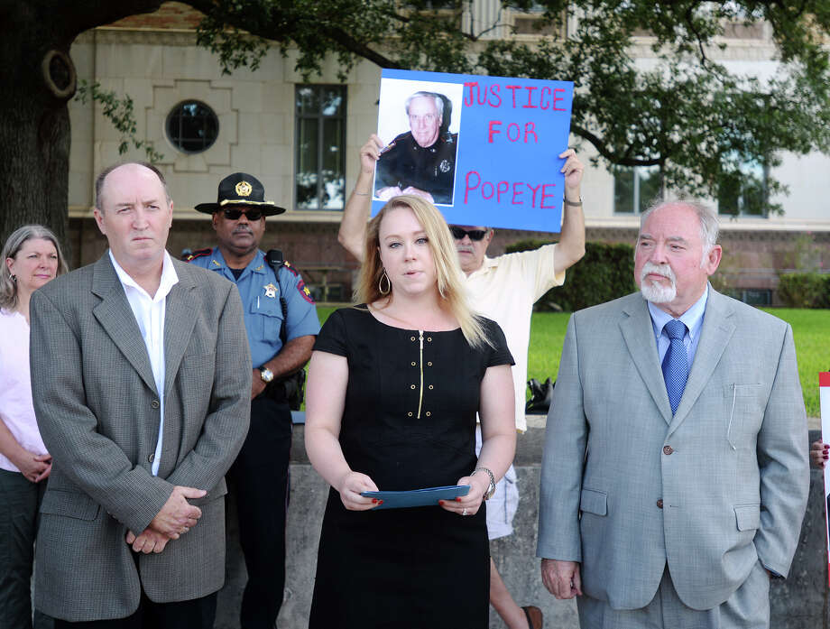 "Tom Barbee, field representative coordinator for CLEAT, Melinda Smith, CLEAT public affairs coordinator, and Charley Wilkison, CLEAT executive director, left to right, hold a brief press conference Monday morning. CLEAT -- the Combined Law Enforcement Associations of Texas -- held a press conference outside the Jefferson County Courthouse on Monday morning to draw attention to the case of Martin J. ""Popeye"" Holmes. The group alleges that Holmes, a chief deputy constable, died from injuries suffered in the line of duty but Jefferson County is denying his family the benefits they are owed. Holmes died almost two years ago after a career in law enforcement that spanned 57 years. Photo taken Monday 7/13/15 Jake Daniels/The Enterprise Photo: Jake Daniels / ©2015 The Beaumont Enterprise/Jake Daniels"