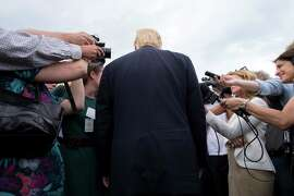 Reporters surround Donald Trump as he attends an event at Trump Golf Links in New York. The media fan the flames started by Trump's rhetoric.