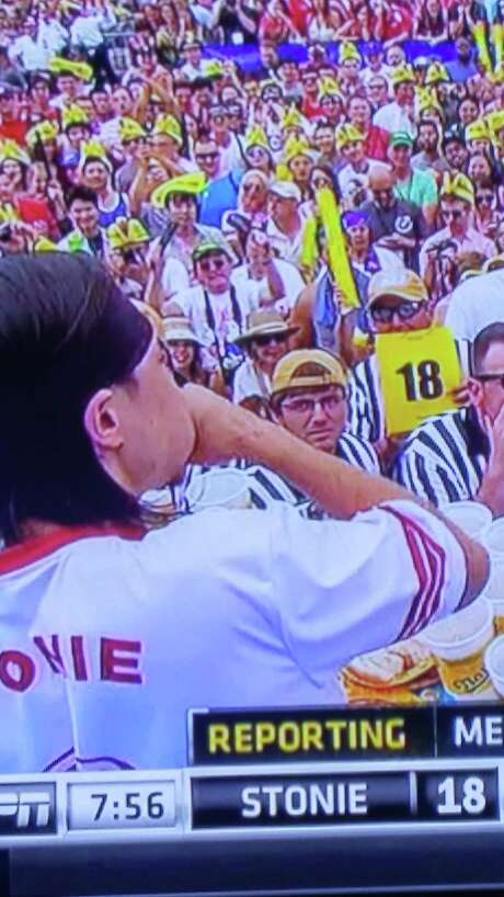 In a screen grab from ESPN's coverage of the Nathan's July Fourth contest, Ken Hoffman judges Matt Stonie's consumption at the 18-dog point in the competition. Photo: Ken Hoffman