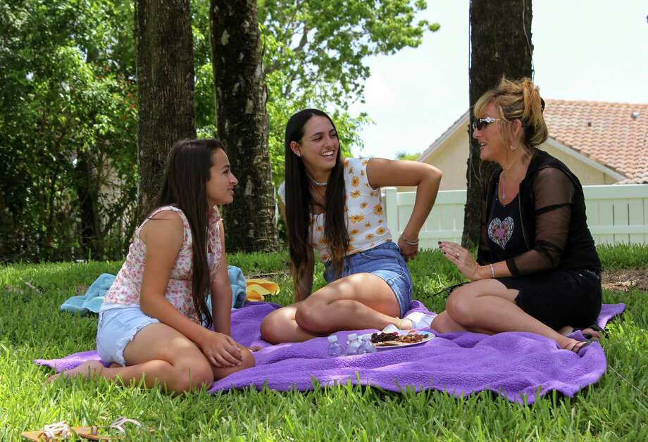 """In this image released by TLC, transgender teen Jazz Jennings, left,  appears with Ari at the park with their mother Jeanette in a scene from """"I Am Jazz,"""" an 11-week unscripted series premiering on TLC on Wednesday at 10 p.m. EDT. (TLC via AP) Photo: HONS / TLC"""