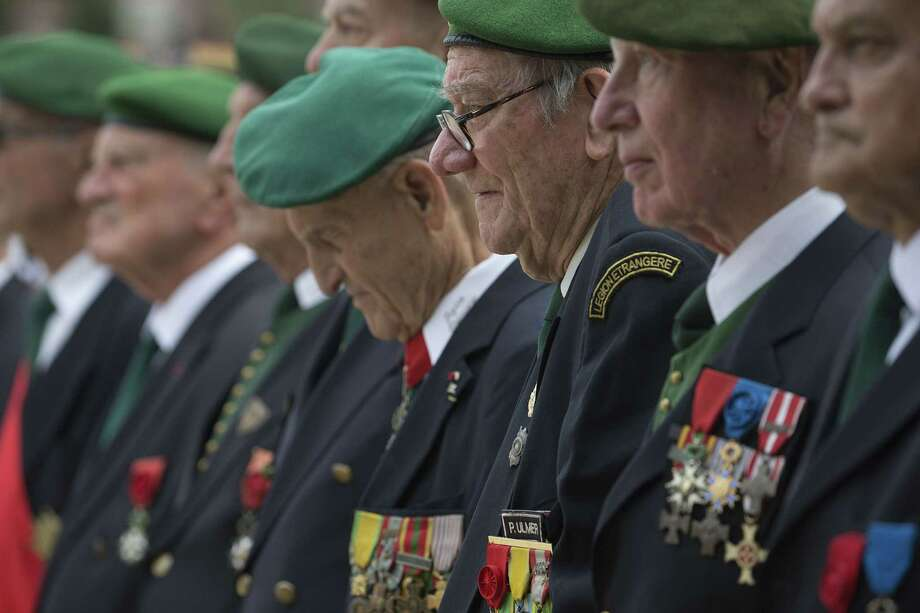 Veterans from the French Legion Etrangere (Foreign Legion) stand during a military ceremony in the Luxembourg Gardens in Paris, on July 13, 2015, the day before France marks Bastille Day celebrations. (Joel Saget/ AFP/ Getty Images Photo: JOEL SAGET, Staff / saget