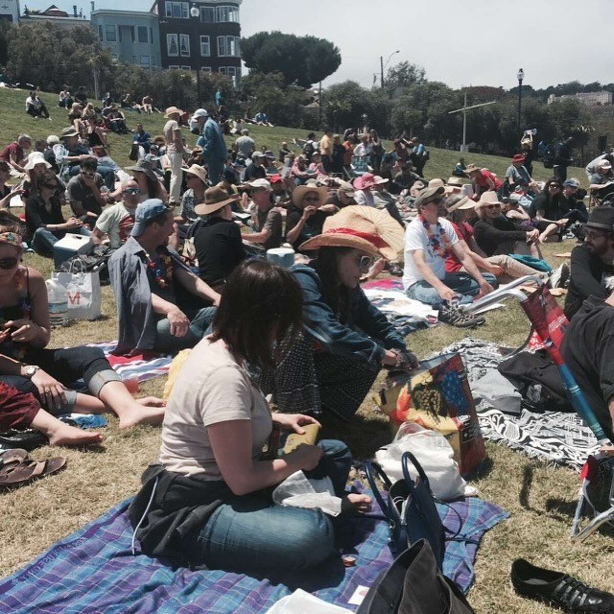 Picnickers gather in Dolores Park for July Fourth San Francisco Mime Troupe show