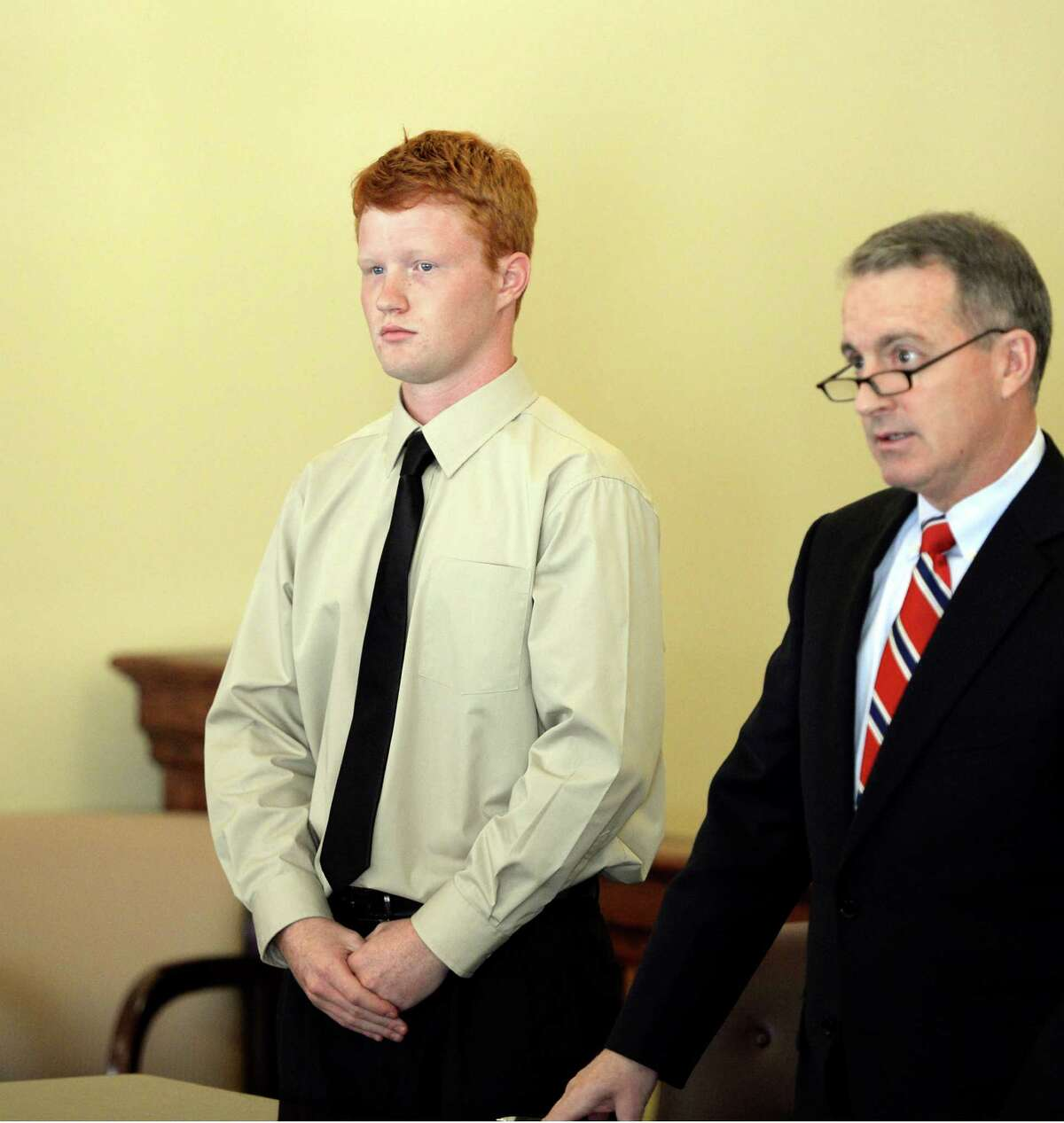 Brendan Hoffman stands in Judge Debra Young's Rensselaer County Court with his attorney Peter J. Moschetti Jr. for his arraignment on charges alleging his involvement in a DWI accident that killed his best friend Nov. 6, 2013, in Troy, N.Y. (Skip Dickstein/Times Union archive)