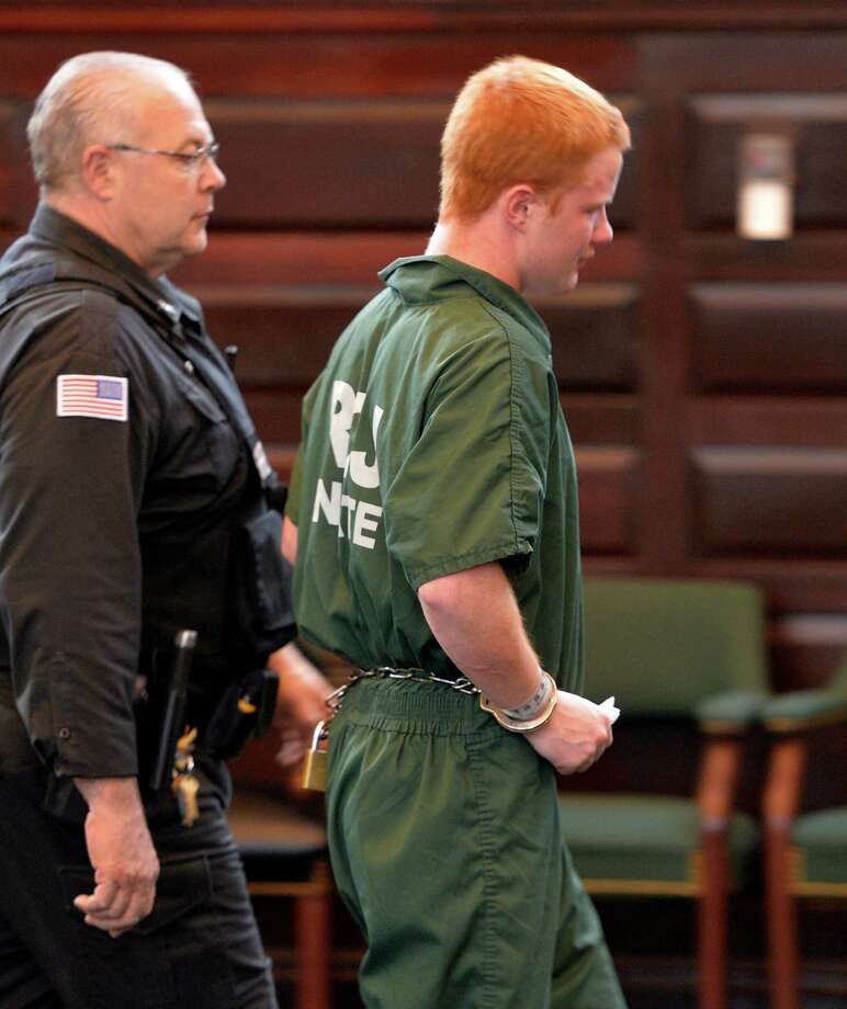 Defendant Brendan Hoffman is led from the courtroom after his sentencing on DWI related fatal crash which killed his best friend Chris Baker Friday afternoon, April 25, 2014, at Rensselaer County Court in Troy, N.Y. (Skip Dickstein / Times Union archive) Photo: SKIP DICKSTEIN / 00026609A