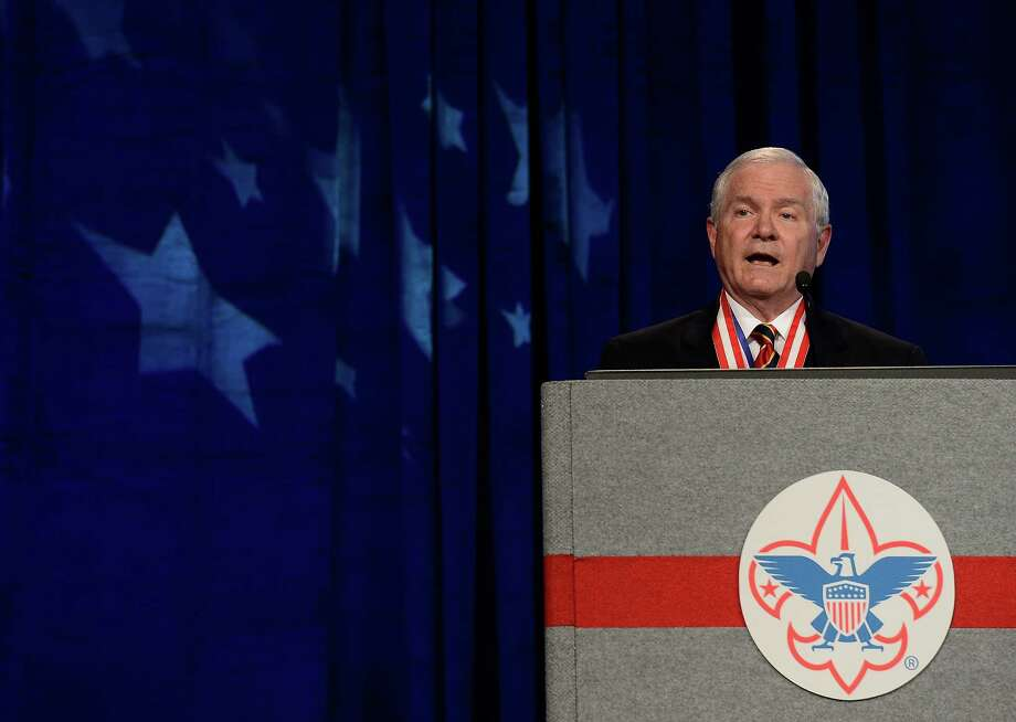 FILE - In this May 23, 2014, file photo, former Defense Secretary Robert Gates addresses the Boy Scouts of America's annual meeting in Nashville, Tenn., after being selected as the organization's new president. The executive committee of the Boy Scouts of America has unanimously approved a resolution that would end the organization's blanket ban on gay adult leaders and let individual scout units set their own policy on the long-divisive issue. The committee action follows an emphatic speech in May by the BSA's president, the former defense secretary declaring that the longstanding ban on participation by openly gay adults was no longer sustainable. (AP Photo/Mark Zaleski, File) Photo: Mark Zaleski, FRE / FR170793 AP