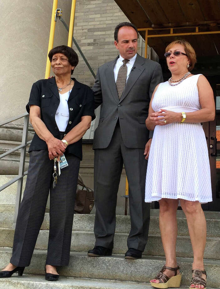 City Clerk Fleeta Hudson, left, and Town Clerk Alma Maya, right, announce on Monday, July 13, 2015 that they are joining Joe Ganim's ticket in his run for mayor of Bridgeport, Conn. Photo: Contributed / Contributed Photo / Connecticut Post Contributed