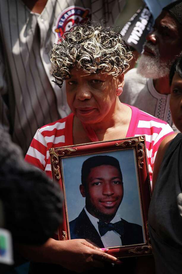 Eric Garner's mother, Gwen Carr, holds a photo of him during a demonstration July 7. Photo: Spencer Platt /Getty Images / 2015 Getty Images