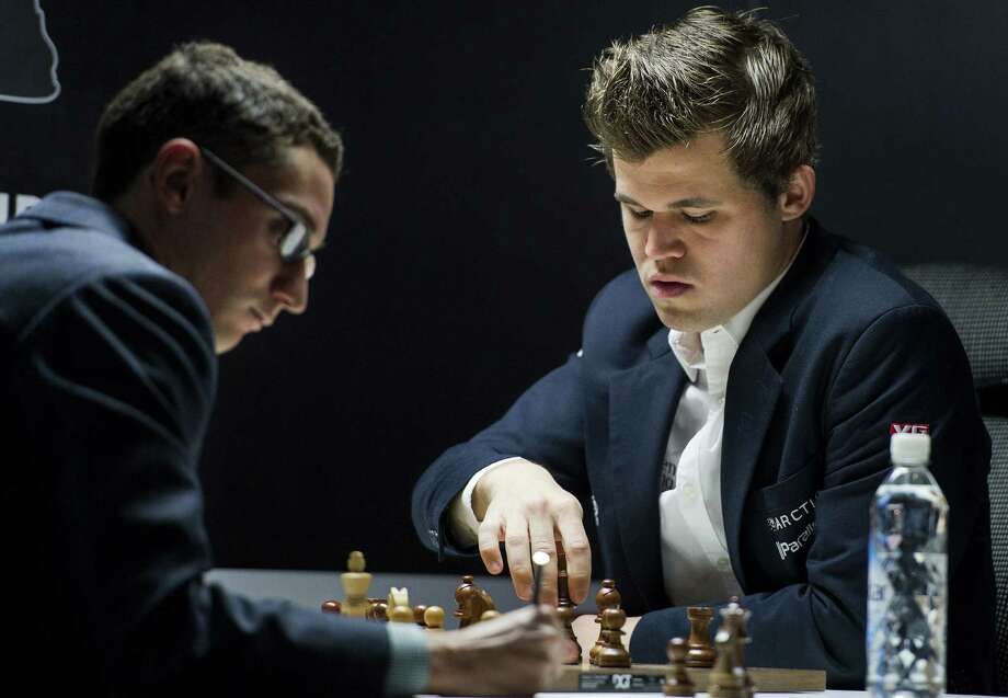 World number one in Chess Magnus Carlsen (R) plays against the world number two Fabiano Caruana in Stavanger, Norway on June 17, 2015. Carlsen lost the match. AFP PHOTO / NTB SCANPIX / CARINA JOHANSEN +++ NORWAY OUT +++CARINA JOHANSEN/AFP/Getty Images Photo: CARINA JOHANSEN / AFP