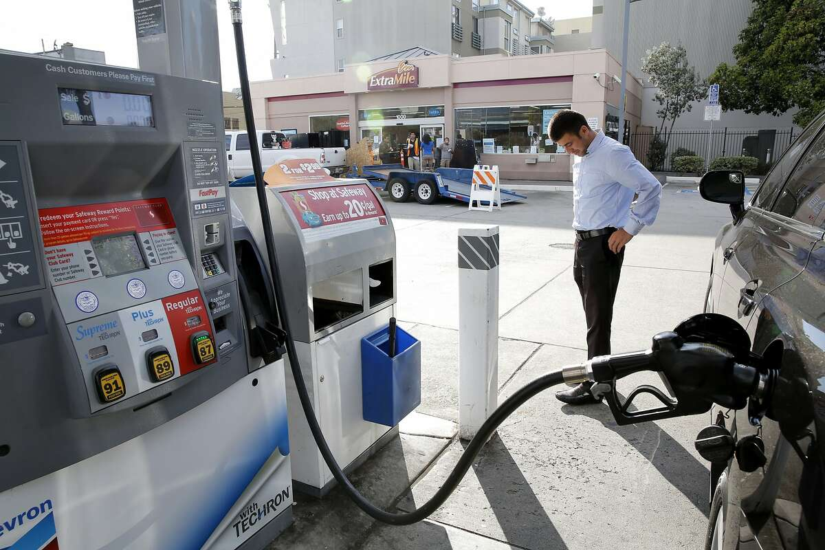 Zey Omonov pumps gas into his car at a gas station in San Francisco, California, on Monday, July 13, 2015. Gas prices in California have spiked by 50 cents since Thursday.