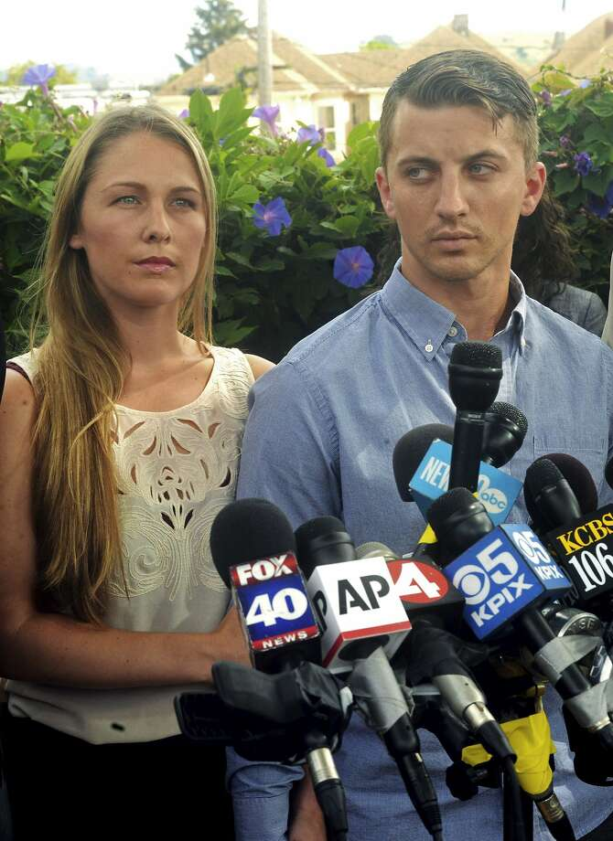 Denise Huskins, left, and her boyfriend Aaron Quinn listen as their attorneys speak at a news conference Monday, July 13, 2015 in Vallejo, Calif. On Tuesday Huskins and Quinn filed a lawsuit against the city for defamation. Photo: Mike Jory, Associated Press