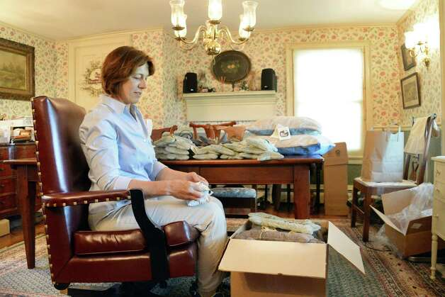 "Seated in her senate chair, former state Sen. Cecilia Tkaczyk's prepares catnip pillows, wool filled dog ""bones"" and dog beds in the parlor of her 18C. farm house for her new company Cece's Wool Friday July 10, 2015 in Delanson, NY. (John Carl D'Annibale / Times Union) Photo: John Carl D'Annibale / 00032551A"