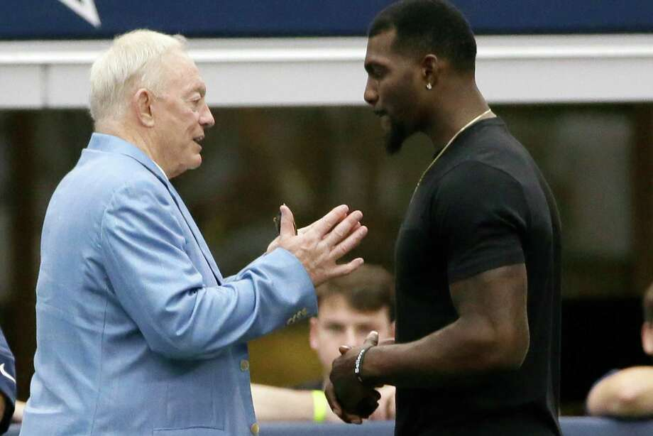 Cowboys receiver Dez Bryant, right, and owner Jerry Jones met during minicamp, but Bryant has threatened to miss games if he doesn't get a long-term deal. Photo: LM Otero, STF / AP