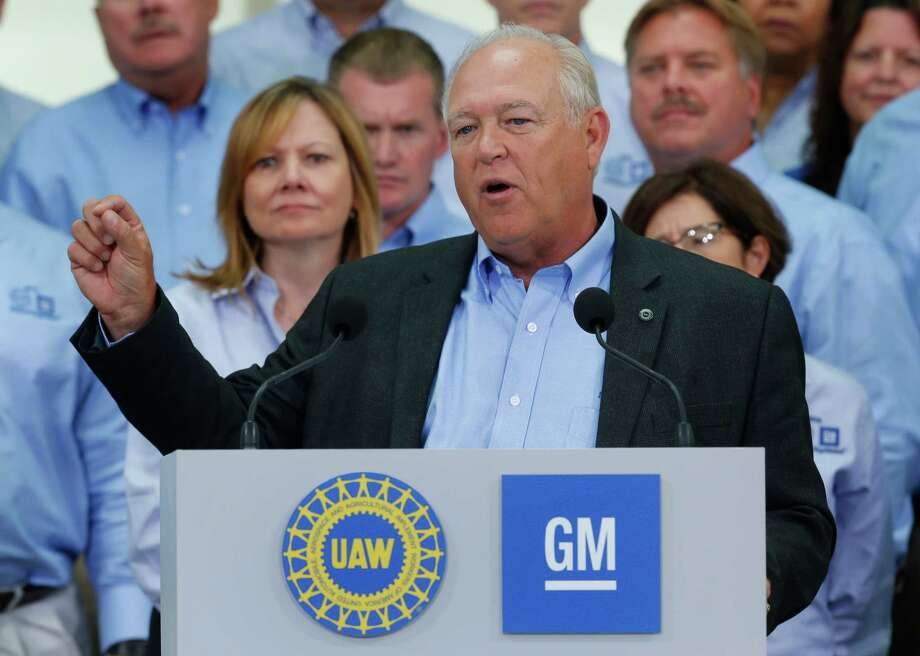 United Auto Workers President Dennis Williams speaks ad General Motors CEO Mary Barra, background left, listens during a ceremony to mark the opening of contract negotiations Monday, July 13, 2015, in Detroit. This year's talks are expected to be the toughest in recent memory. (AP Photo/Paul Sancya) Photo: Paul Sancya, STF / AP