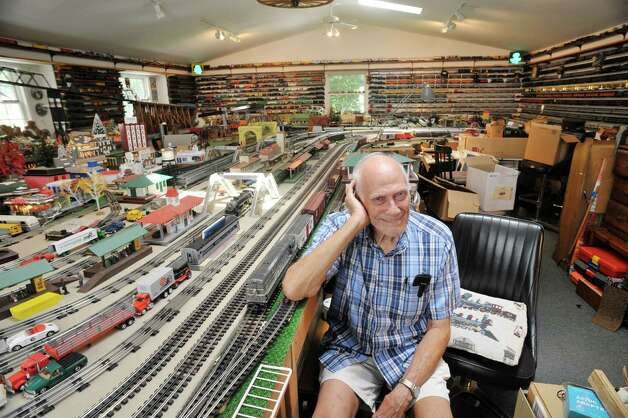 Gerry Winn poses with his huge train set and collection of train cars and engines on Wednesday, July 8, 2015, in Delmar, N.Y.      (Paul Buckowski / Times Union) Photo: PAUL BUCKOWSKI / 00032481A