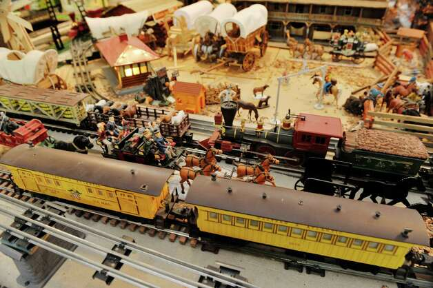 A view of some of the train cars and other items that make up the huge train set, seen here on Wednesday, July 8, 2015, in Delmar, N.Y.  The trains are part of the huge collection of Gerry Winn.  This section of the table is a western scene.    (Paul Buckowski / Times Union) Photo: PAUL BUCKOWSKI / 00032481A