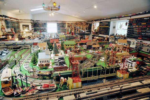 A view of some of the train cars, tracks and other items that make up the huge train set, seen here on Wednesday, July 8, 2015, in Delmar, N.Y.  The trains are part of the huge collection of Gerry Winn.    (Paul Buckowski / Times Union) Photo: PAUL BUCKOWSKI / 00032481A