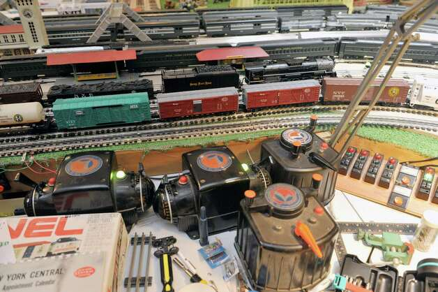 A view of some of the train cars and the controllers to operate the trains that make up the huge train set, seen here on Wednesday, July 8, 2015, in Delmar, N.Y.  The trains are part of the huge collection of Gerry Winn.    (Paul Buckowski / Times Union) Photo: PAUL BUCKOWSKI / 00032481A