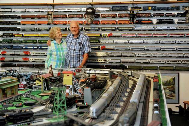 Ginny Winn, left, and her husband Gerry Winn pose for a photograph with their huge train set and collection of train cars and engines on Wednesday, July 8, 2015, in Delmar, N.Y.      (Paul Buckowski / Times Union) Photo: PAUL BUCKOWSKI / 00032481A