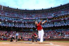 CINCINNATI, OH - JULY 13:  National League All-Star Todd Frazier #21 of the Cincinnati Reds bats during the Gillette Home Run Derby presented by Head & Shoulders at the Great American Ball Park on July 13, 2015 in Cincinnati, Ohio.  (Photo by Elsa/Getty Images)