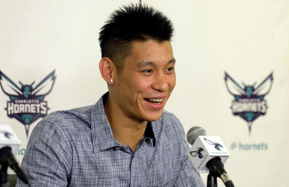 Newly acquired Charlotte Hornets basketball point guard Jeremy Lin speaks during a news conference at Time Warner Cable Arena, Monday, July 13, 2015, in Charlotte, N.C. (David T. Foster/The Charlotte Observer via AP) Photo: David T. Foster, III, MBI / The Charlotte Observer
