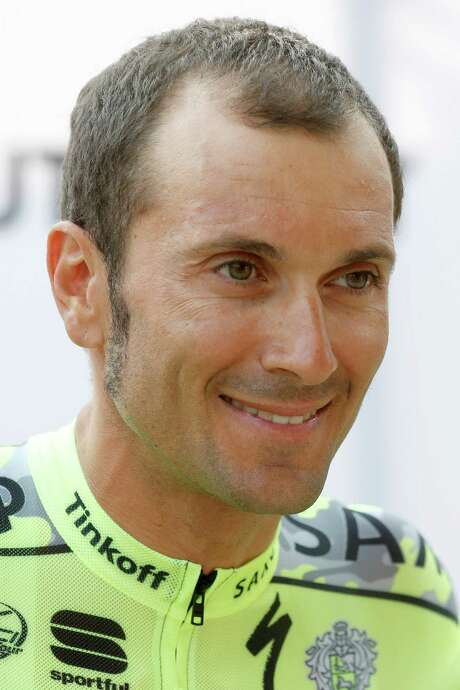 In this ThursdayJuly 2, 2015 image Italy's Ivan Basso poses for photographers during the team presentation in Utrecht, Netherland. Italian veteran Basso, a two-time Giro d'Italia winner and once a great rival of Lance Armstrong, has announced that he has cancer in his left testicle and is dropping out of the Tour de France. (AP Photo/Laurent Cipriani) Photo: Laurent Cipriani, STR / AP