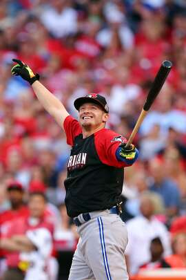 CINCINNATI, OH - JULY 13:  American League All-Star Josh Donaldson #20 of the Toronto Blue Jays points during the Gillette Home Run Derby presented by Head & Shoulders at the Great American Ball Park on July 13, 2015 in Cincinnati, Ohio.  (Photo by Elsa/Getty Images)