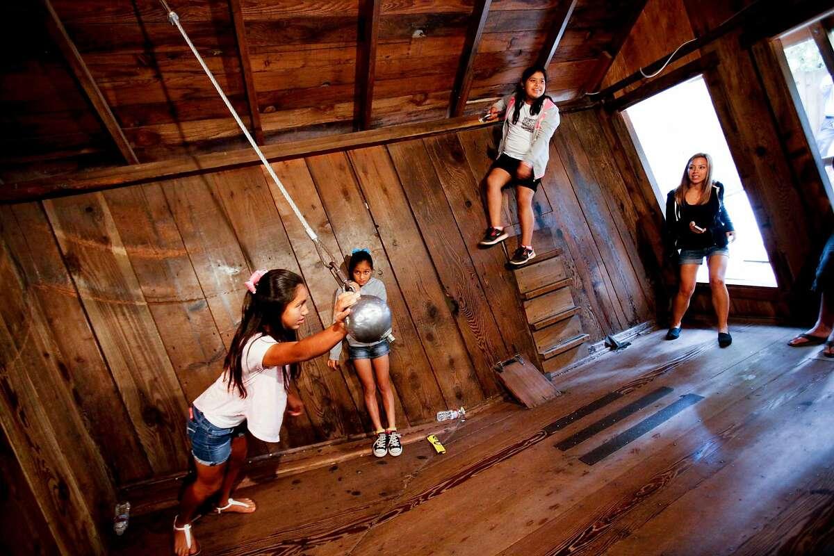 Visitors tour the Mystery Spot in Santa Cruz, Calif., on Thursday, July 2, 2015.