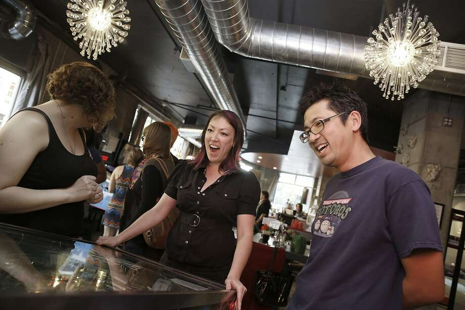 Sarah Donovan (left), Kimberly Blum and David Lee at Scarlet City Espresso Bar in Emeryville, open since last August. The town known for big-box stores is cultivating a local restaurant scene with cafes, pubs and restaurants. Photo: Liz Hafalia, The Chronicle