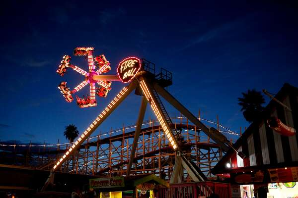 The Fire Ball with the Giant Dipper behind it on the boardwalk in Santa Cruz, Calif., on Friday, July 3, 2015.
