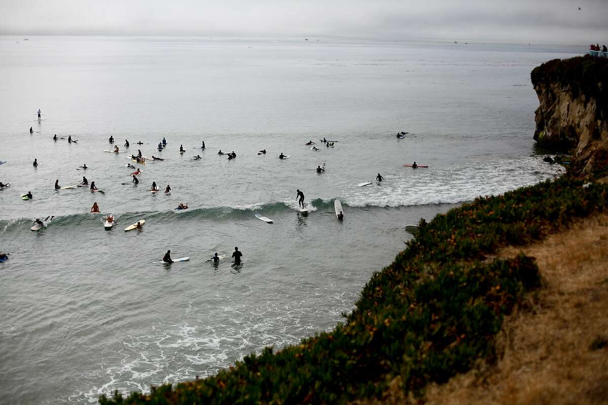 Surfers at Steamers Lane in Santa Cruz.