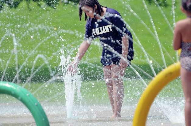 Bryanna Bascombe, 12, of Albany cools off in the spray pool at Krank Park on Monday, July 13, 2015, in Albany, N.Y.  (Paul Buckowski / Times Union)