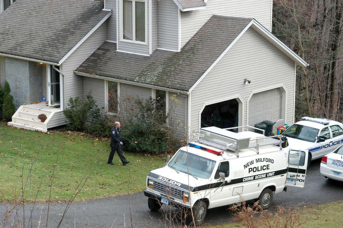 Police work at the home on Cortland Drive in New Milford home where 41-year-old Neil Fergus stabbed his estranged wife, Catherine Fergus, and attacked his mother-in-law on the afternoon of Nov. 14, 2009.