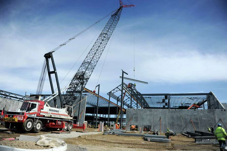 With the spring thaw, construction is in full swing Wednesday, April 1, 2015, at Bridgeport's Steel Point development, the future site of Bass Pro Shops. Photo: Autumn Driscoll / Autumn Driscoll / Connecticut Post