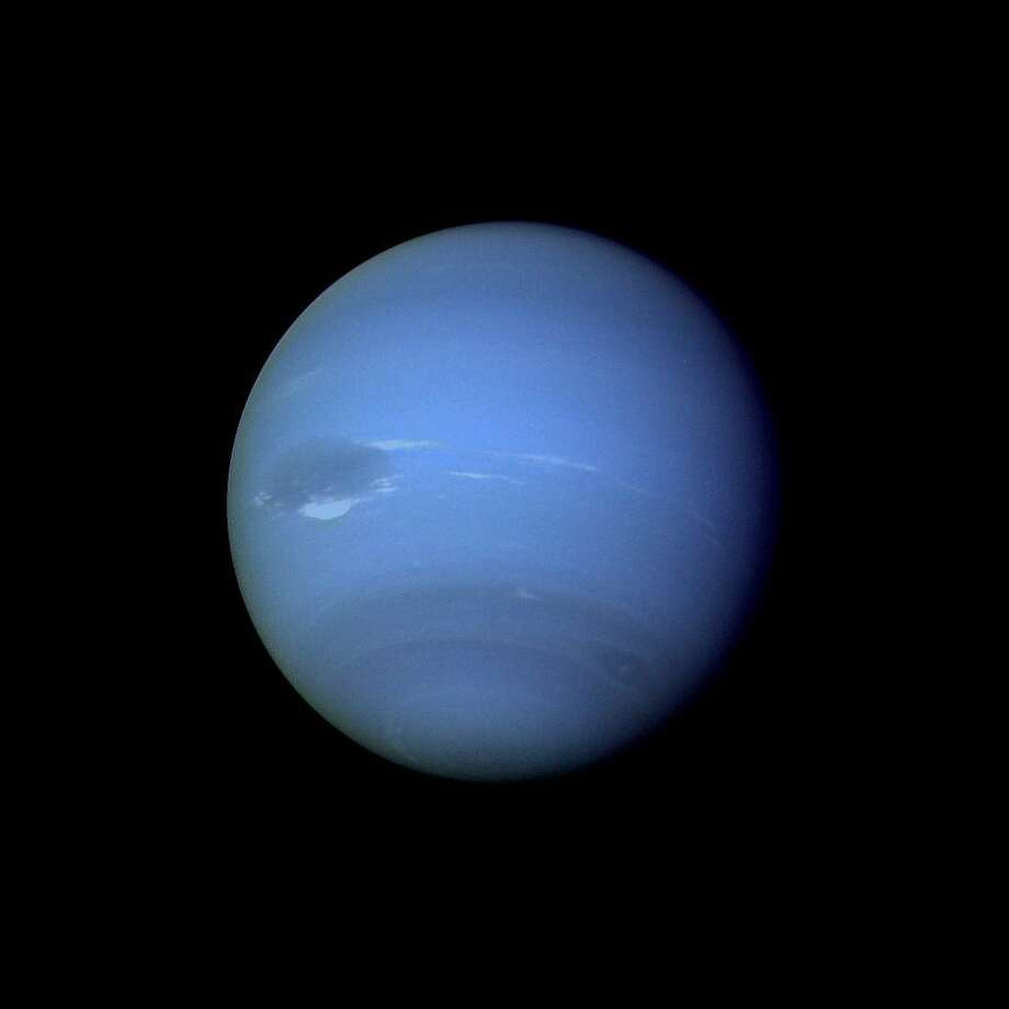 Voyager 2 Image of Neptune: This picture of Neptune was produced from the last whole planet images taken through the green and orange filters on the Voyager 2 narrow angle camera.