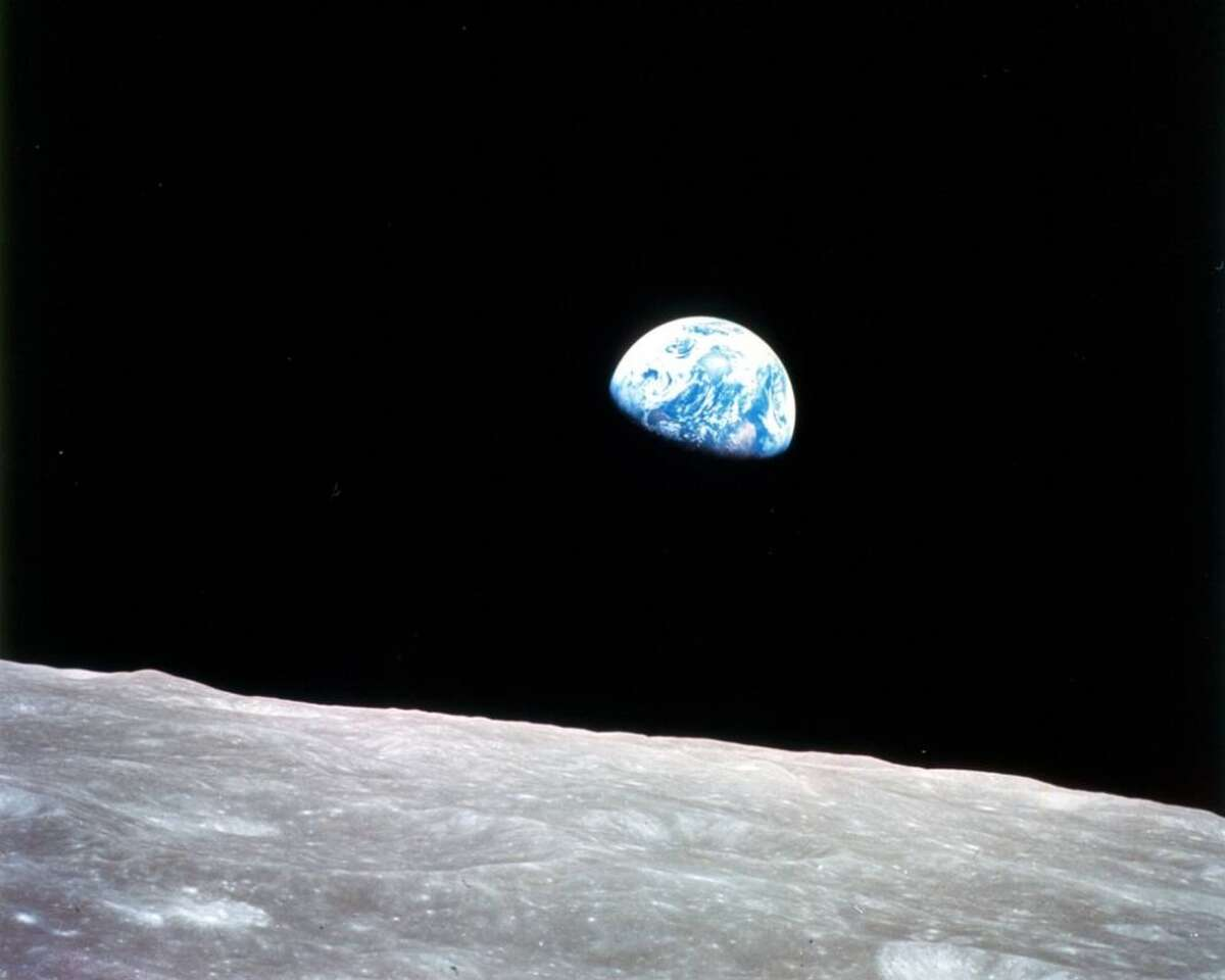 Earthrise: Apollo 8, the first manned mission to the moon, entered lunar orbit on Christmas Eve, Dec. 24, 1968. That evening, the astronauts-Commander Frank Borman, Command Module Pilot Jim Lovell, and Lunar Module Pilot William Anders-held a live broadcast from lunar orbit, in which they showed pictures of the Earth and moon as seen from their spacecraft.