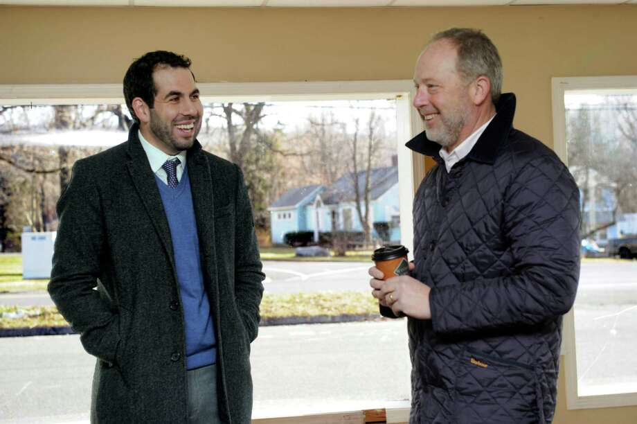 A change in tax abatement offers by the town would sweeten the pot for deals like the one discussed here in December by Luigi Fulinello, left, economic developement director for New Milford, and Todd Payne, of Goodfellow Real Estate, speaking together at the former Valley Dodge property in New Milford. Photo: Carol Kaliff / Carol Kaliff / The News-Times